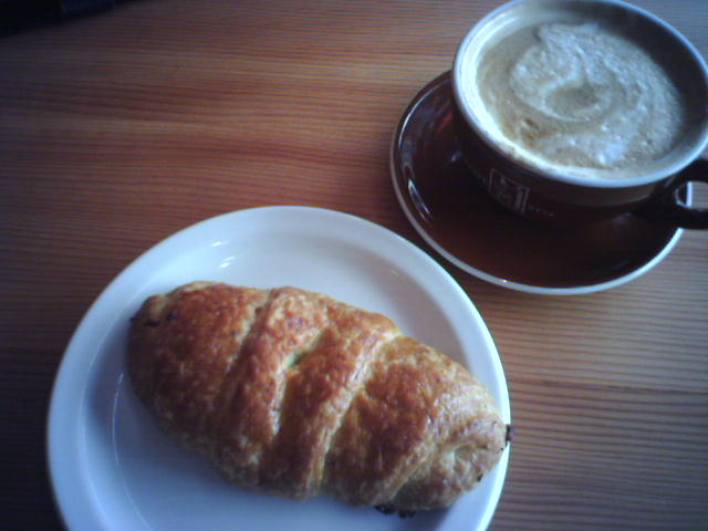 Coffee, savory croissant and Pink Martini news