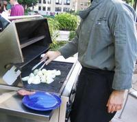 a_local_chef_gets_the_onions_ready_for_grilling_at_a_recent_neighborhood_party_sponsored_by_our_wonderful_building
